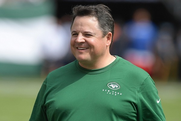 New York Jets offensive coordinator Dowell Loggains smiles before an NFL football game against the Buffalo Bills Sunday, Sept. 8, 2019, in East Rutherford, N.J. (AP Photo/Bill Kostroun)