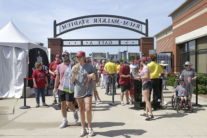 Fans walk through the games, Sunday, June 13, 2021 before the start of Game 3 of the Fayetteville Super Regional at Baum-Walker Stadium in Fayetteville. Check out nwaonline.com/210614Daily/ for today's photo gallery. .(NWA Democrat-Gazette/Charlie Kaijo)