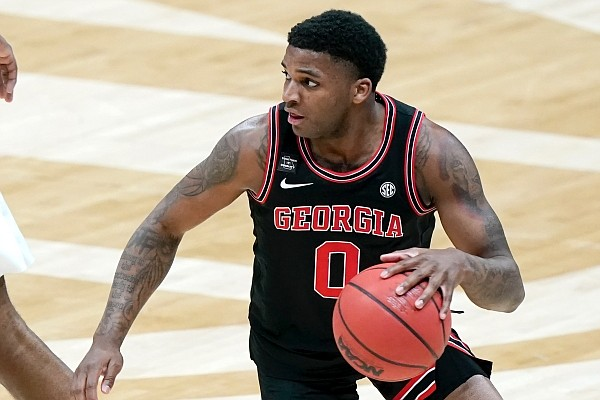 Georgia's K.D. Johnson plays against Missouri in an NCAA college basketball game in the Southeastern Conference Tournament Thursday, March 11, 2021, in Nashville, Tenn. (AP Photo/Mark Humphrey)