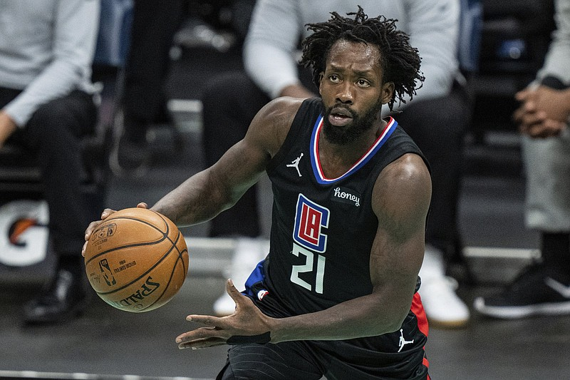Los Angeles Clippers guard Patrick Beverley (21) brings the ball up court against the Charlotte Hornets during an NBA basketball game in Charlotte, N.C., Thursday, May 13, 2021. (AP Photo/Jacob Kupferman)