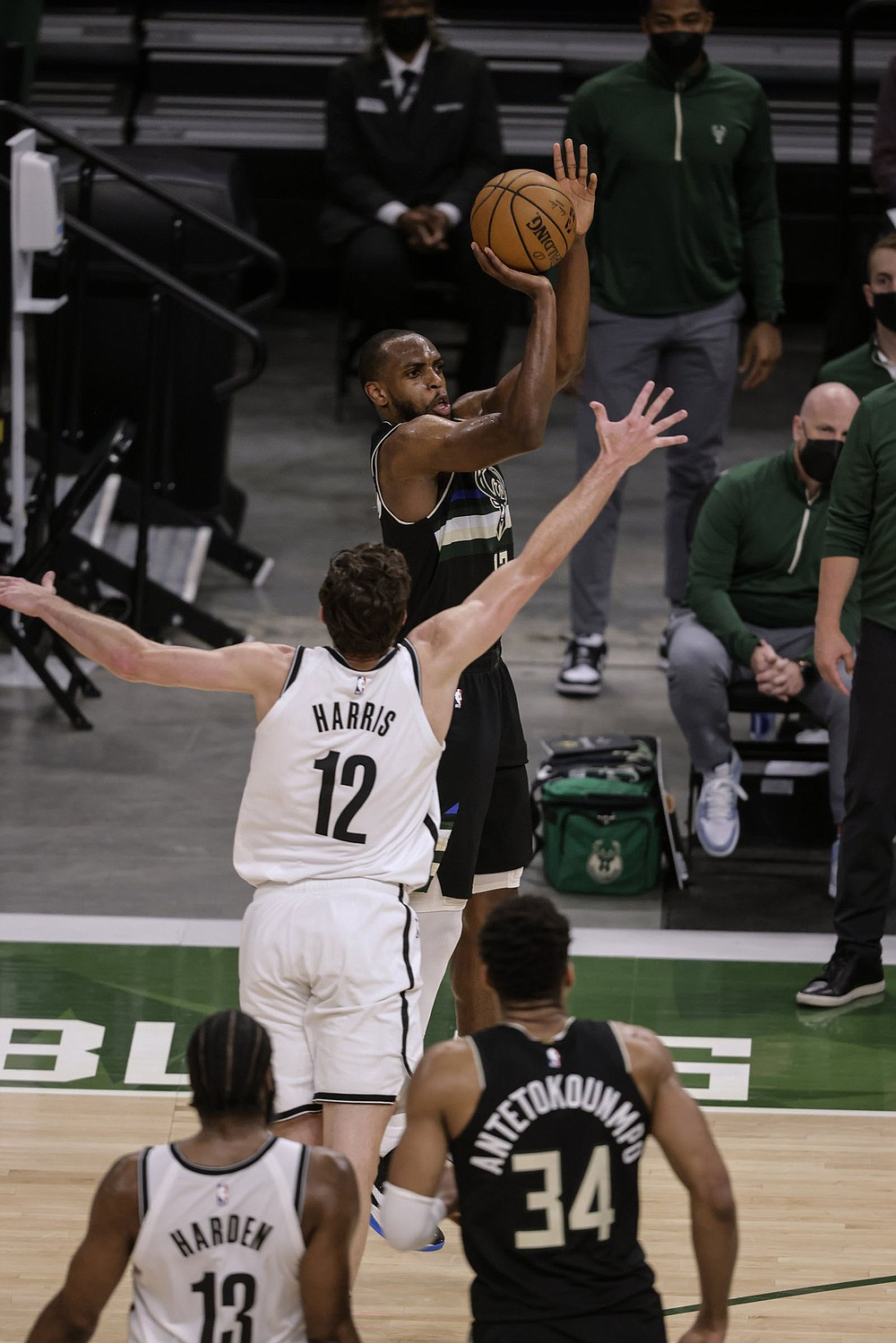 Milwaukee forward Khris Middleton shoots over Brooklyn forward Joe Harris (12) on Thursday during the Bucks' 104-89 victory over the Nets in Milwaukee. Middleton scored a game-high 38 points for the Bucks, who forced a Game 7 in their NBA Eastern Conference semifinal series Saturday. (AP/Jeffrey Phelps)