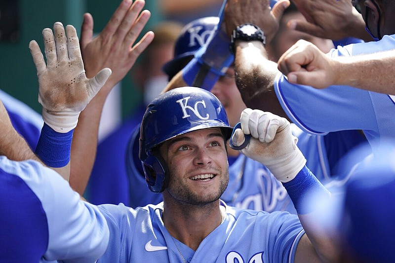 Kansas City Royals' Andrew Benintendi celebrates in the dugout after hitting a home run during the fifth inning of a baseball game against the Minnesota Twins Saturday, June 5, 2021, in Kansas City, Mo.(AP Photo/Charlie Riedel)