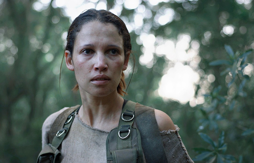 """Typical horror movie protagonist Gabi (Monique Rockman) is a forest ranger who becomes entangled with a mysterious natural force and father and son who have gone native in Jaco Bouwer's """"Gaia."""""""