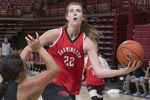 Farmington's Jenna Lawrence goes up for a shot during a team camp Wednesday June 16, 2021, at Bud Walton Arena in Fayetteville.