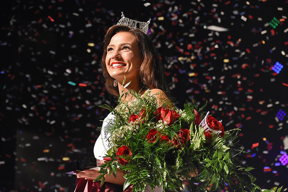 Confetti surrounds Miss University of Arkansas Whitney Williams after she was named Miss Arkansas 2021 at the pageant Saturday night at Robinson Center in Little Rock. More photos at arkansasonline.com/620missar/. (Arkansas Democrat-Gazette/Staci Vandagriff)