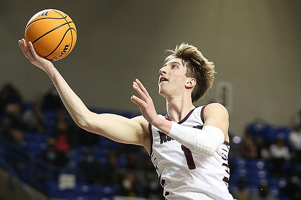 Morrilton's Joseph Pinion goes up for a shot during the Class 4A boys state championship game against Mills on Saturday, March 10, 2021, in Hot Springs. Pinion is committed to play college basketball at Arkansas.