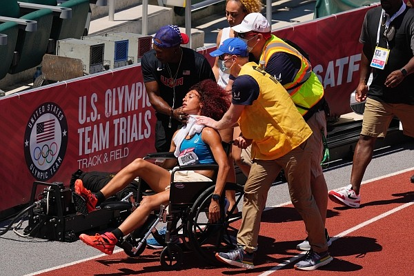 Taliyah Brooks is helped off track after collapsing during the heptathlon at the U.S. Olympic Track and Field Trials Sunday, June 27, 2021, in Eugene, Ore. Events were suspended due to high temperatures. (AP Photo/Charlie Riedel)