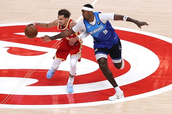Atlanta Hawks guard Trae Young draws a foul from Milwaukee Bucks forward Bobby Portis during the second quarter in Game 3 of the NBA Eastern Conference basketball finals, Sunday, June 27, 2021, in Atlanta. (Curtis Compton/Atlanta Journal-Constitution via AP)