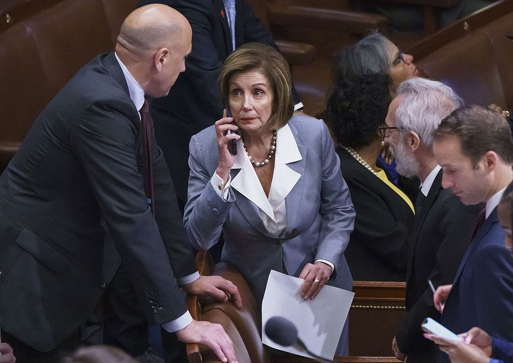 """House Speaker Nancy Pelosi manages the vote Wednesday on the House floor on a measure to create a select committee to investigate the Jan. 6 riot at the Capitol. """"We will be judged by future generations as to how we value our democracy,"""" Pelosi told colleagues before the vote. (AP/J. Scott Applewhite)"""