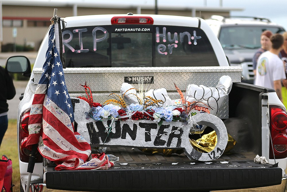 A truck bed serves as a memorial to 17-year-old Hunter Brittain during a protest Thursday at the Lonoke County sheriff's office. Brittain was shot three times by a now-fired Lonoke County sheriff's deputy while the teen was holding a can of antifreeze, said Jesse Brittain, the teen's uncle. (Arkansas Democrat-Gazette/Thomas Metthe)