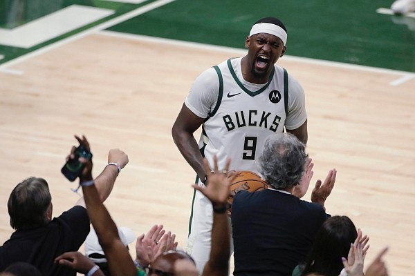 Milwaukee Bucks' Bobby Portis yells to the crowd during the second half of Game 5 of the team's NBA basketball playoffs Eastern Conference finals against the Atlanta Hawks on Thursday, July 1, 2021, in Milwaukee. (AP Photo/Aaron Gash)