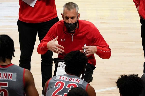 Gardner Webb head coach Tim Craft talks with the team in a timeout during the first half of an NCAA college basketball game against Pittsburgh, Saturday, Dec. 12, 2020, in Pittsburgh. (AP Photo/Keith Srakocic)