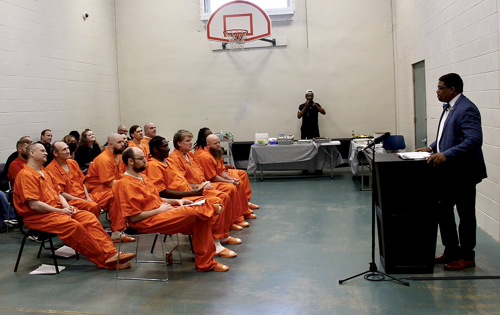 Jefferson County Sheriff Lafayette Woods Jr. on Thursday congratulates the first graduates of the Comprehensive Opioid Abuse Site-Based Program who completed a 12-week reentry and drug rehabilitation course.  (Pine Bluff Commercial/Eplunus Colvin)