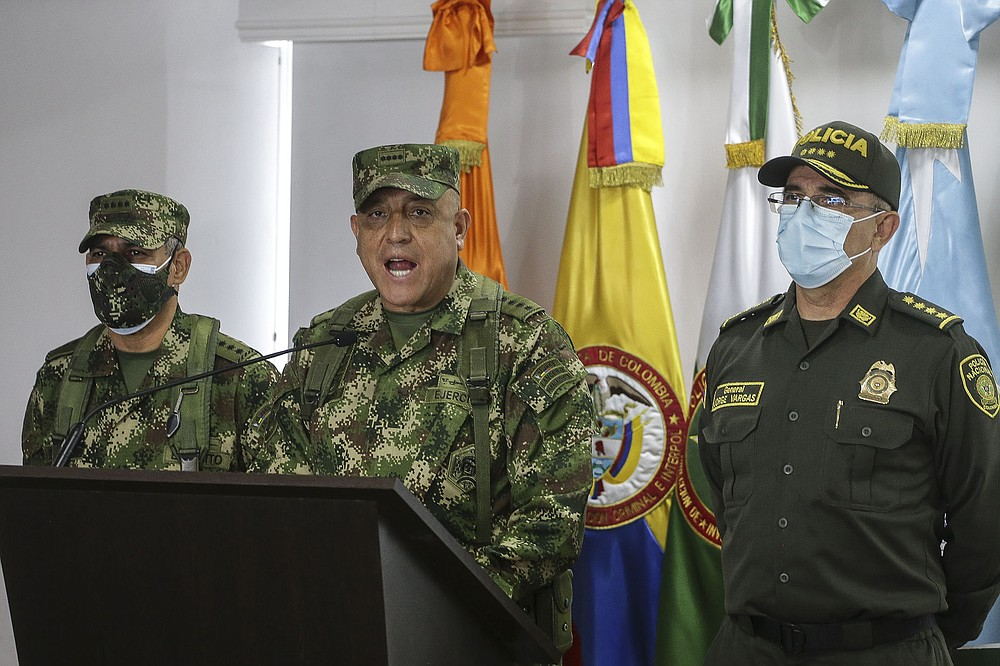 """Colombian Armed Forces Commander Gen. Luis Fernando Navarro speaks during a news conference Friday in Bogota on the reported participation of former Colombian soldiers in the assassination of Haiti's President Jovenel Moise. National Police Director Gen. Jorge Luis Vargas (right) said four unnamed companies were involved in the """"recruitment, the gathering of these people."""" (AP/Ivan Valencia)"""
