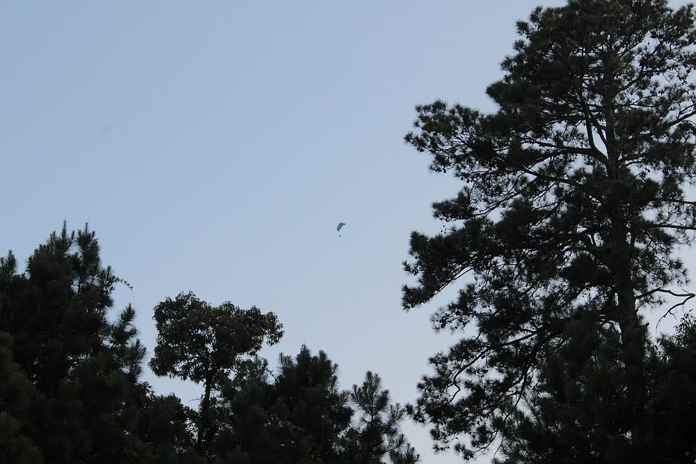Don Guthrie flies his powered paraglider above El Dorado on Monday, July 5. (Caitlan Butler/News-Times)