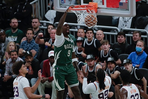 Milwaukee Bucks' Bobby Portis (9) dunks during the first half of Game 3 of basketball's NBA Finals against the Phoenix Suns, Sunday, July 11, 2021, in Milwaukee. (AP Photo/Aaron Gash)