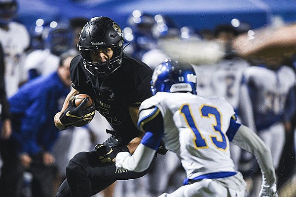 Bentonville receiver Chas Nimrod (5) runs with the ball during a game against North Little Rock on Friday, Nov. 29, 2019, in Bentonville.