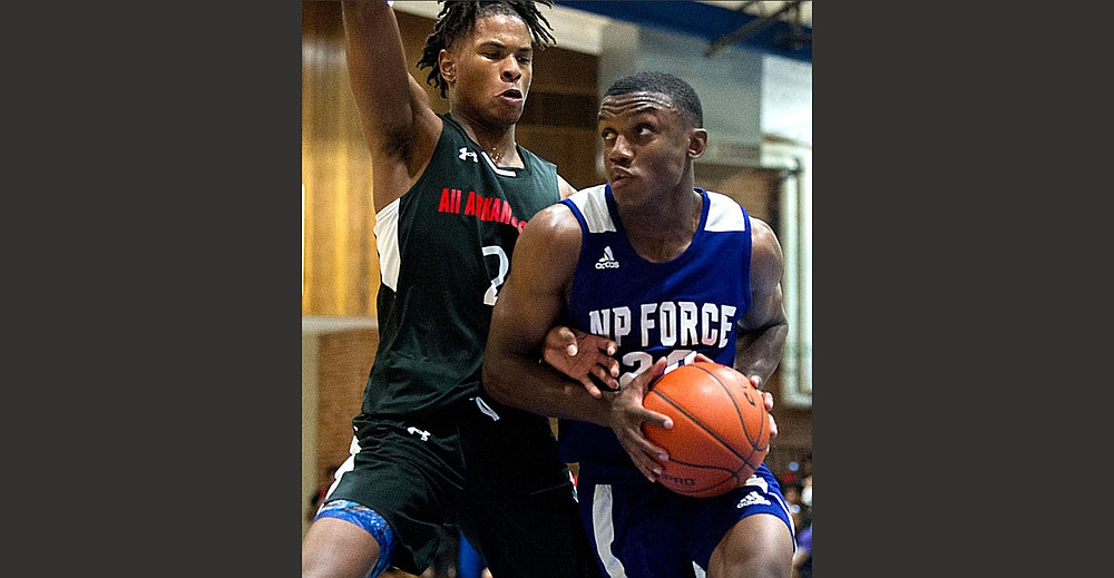 Guard Derrian Ford of Magnolia, shown playing for NP Force in last month's Real Deal in the Rock, orally committed to the University of Arkansas on Wednesday. He chose the Razorbacks over more than 20 other scholarship offers. (Arkansas Democrat-Gazette/Stephen Swofford)