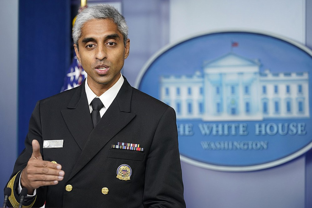 """Surgeon General Dr. Vivek Murthy, speaking Thursday at the White House, called for a national effort to fight misinformation about the coronavirus and covid-19 vaccines. """"Misinformation poses an imminent and insidious threat to our nation's health,"""" Murthy said. (AP/Susan Walsh)"""