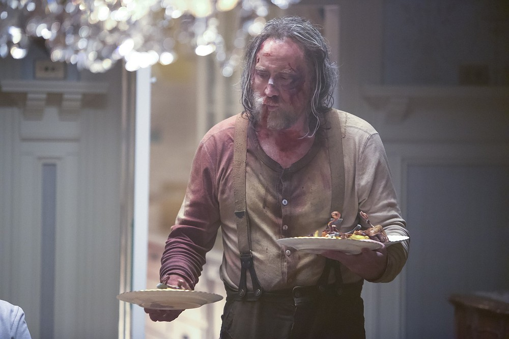"""Former celebrity chef Rob (Nicolas Cage) remembers every meal he ever prepared, every diner he ever served, in Michael Sarnoski's """"Pig,"""" a meditation on what we hold important and what we can live without."""