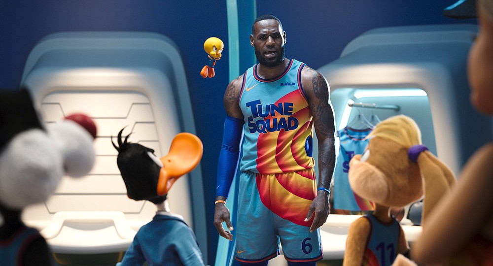 """The band's back together: Slyvester the Cat, Daffy Duck, Tweety Bird and Lola Bunny size up LeBron James in this scene from Malcolm D. Lee's """"Space Jam: A New Legacy."""""""