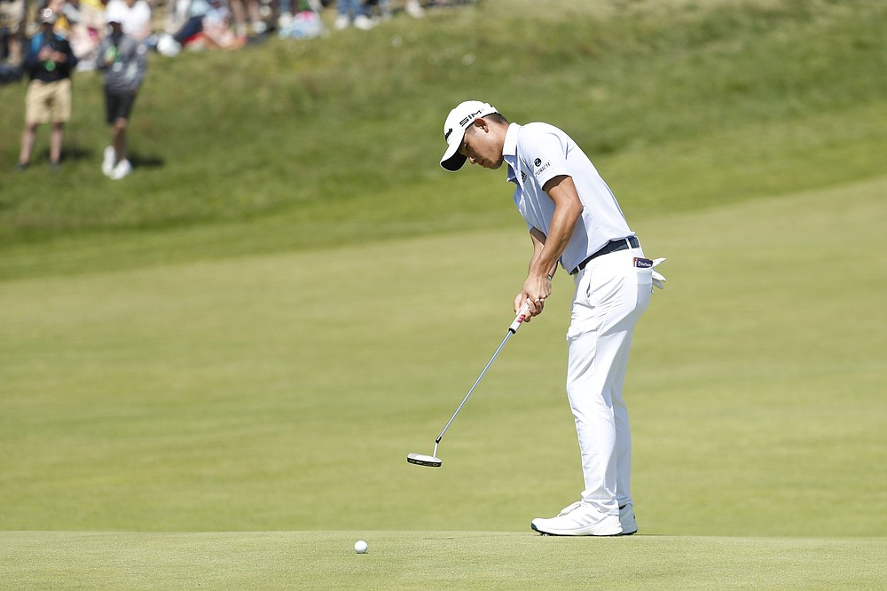Collin Morikawa putts on the 16th green during the second round of the British Open on Friday at Royal St George's in Sandwich, England. Morikawa's 9-under 131 puts him two shots behind leader Louis Oosthuizen. More photos at arkansasonline.com/717british/ (AP/Peter Morrison)