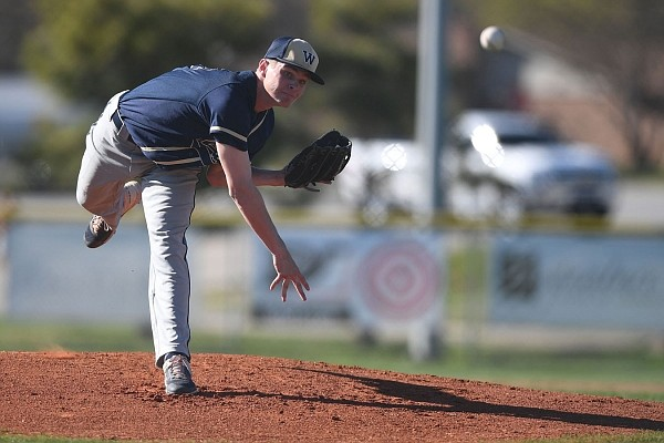 Bentonville West's Dylan Carter pitches against Springdale Har-Ber at the Randall Tyson Recreational Complex in Springdale.