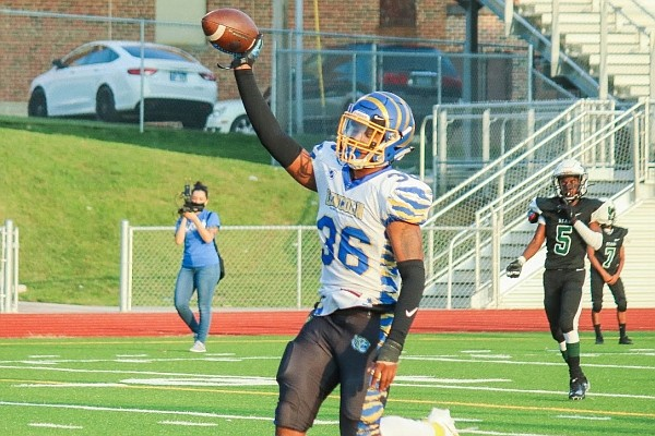 Jermaine Hamilton-Jordan scores a touchdown during his senior season at Lincoln College Prep in Kansas City, Mo.