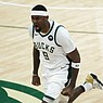 Milwaukee Bucks center Bobby Portis celebrates during the first half against the Phoenix Suns in Game 4 of the NBA Finals on Wednesday, July 14, 2021, in Milwaukee. (AP Photo/Aaron Gash)