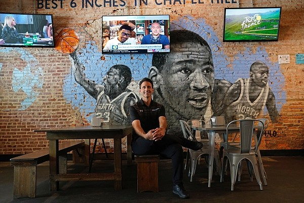 Bret Oliverio poses at his Sup Dogs restaurant in Chapel Hill, N.C., Thursday, July 15, 2021. (AP Photo/Gerry Broome)