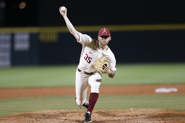 Arkansas Ryan Costeiu (35) pitches, Sunday, June 6, 2021 during the sixth inning in the NCAA Fayetteville Regional at Baum-Walker Stadium in Fayetteville.