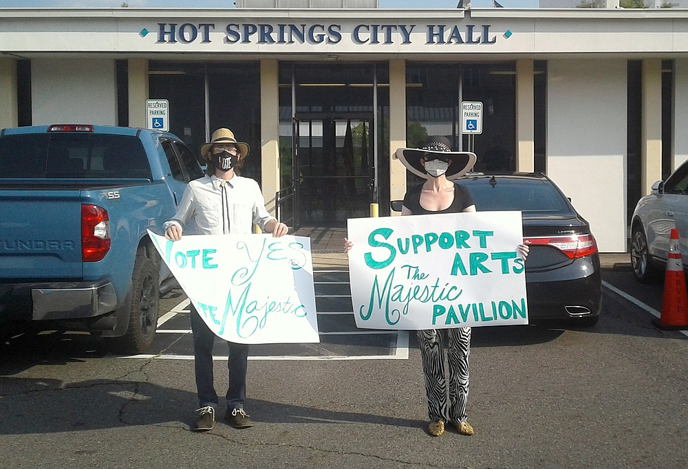 Ben Droz, left, and Rie Schaffer show their support for The Majestic project Tuesday at City Hall. - Photo by David Showers of The Sentinel-Record