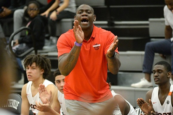 Former Fayetteville, Arkansas and NBA guard Ronnie Brewer coaches from the bench Friday on April 12, 2019, during play at Fayetteville High School.
