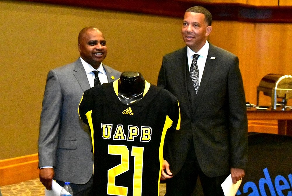 UAPB Coach Doc Gamble meets with SWAC Commissioner Charles McClelland on Tuesday in Birmingham, Ala.  (Pine Bluff Commercial/I.C. Murrell)