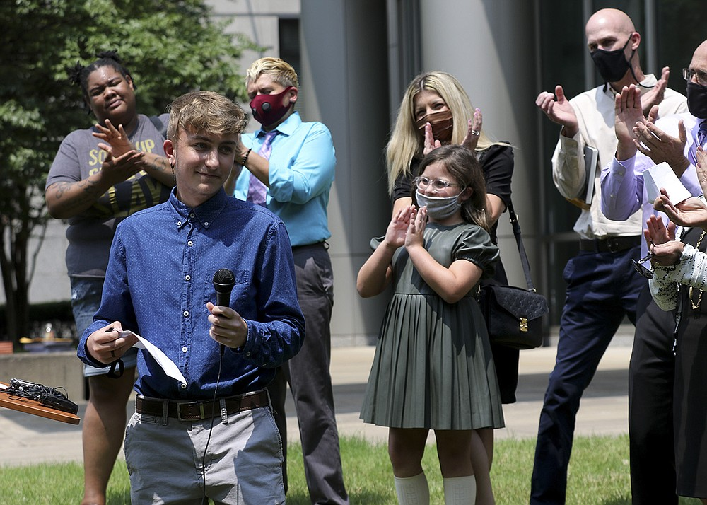 """Expressing support for other transgender youths in the state, plaintiff Dylan Brandt, 15, said Wednesday outside federal court that """"we have your back, and we will continue to fight on your behalf."""" (Arkansas Democrat-Gazette/Thomas Metthe)"""