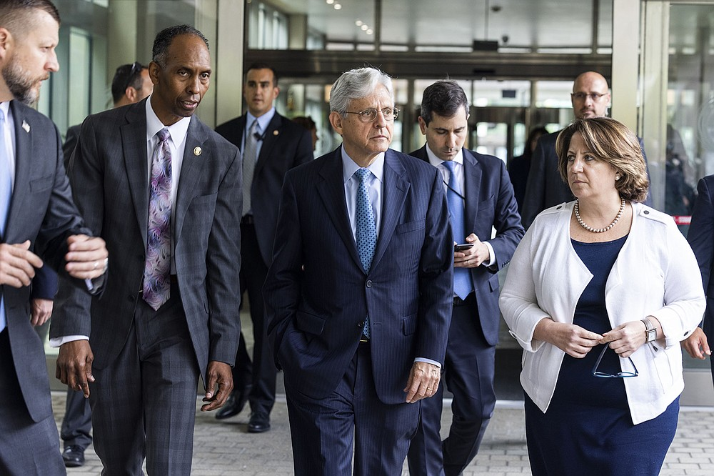 """Attorney General Merrick Garland (center) leaves the Bureau of Alcohol, Tobacco Firearms and Explosives headquarters Thursday in Washington with ATF acting Director Marvin Richardson and Deputy Attorney General Lisa Monaco after announcing gun crime """"strike forces"""" for five major areas of the country. """"This is not a short-term infusion of resources, rather it's a long-term, coordinated, multijurisdictional strategy,"""" a Justice Department official said. (AP/Jim Lo Scalzo)"""