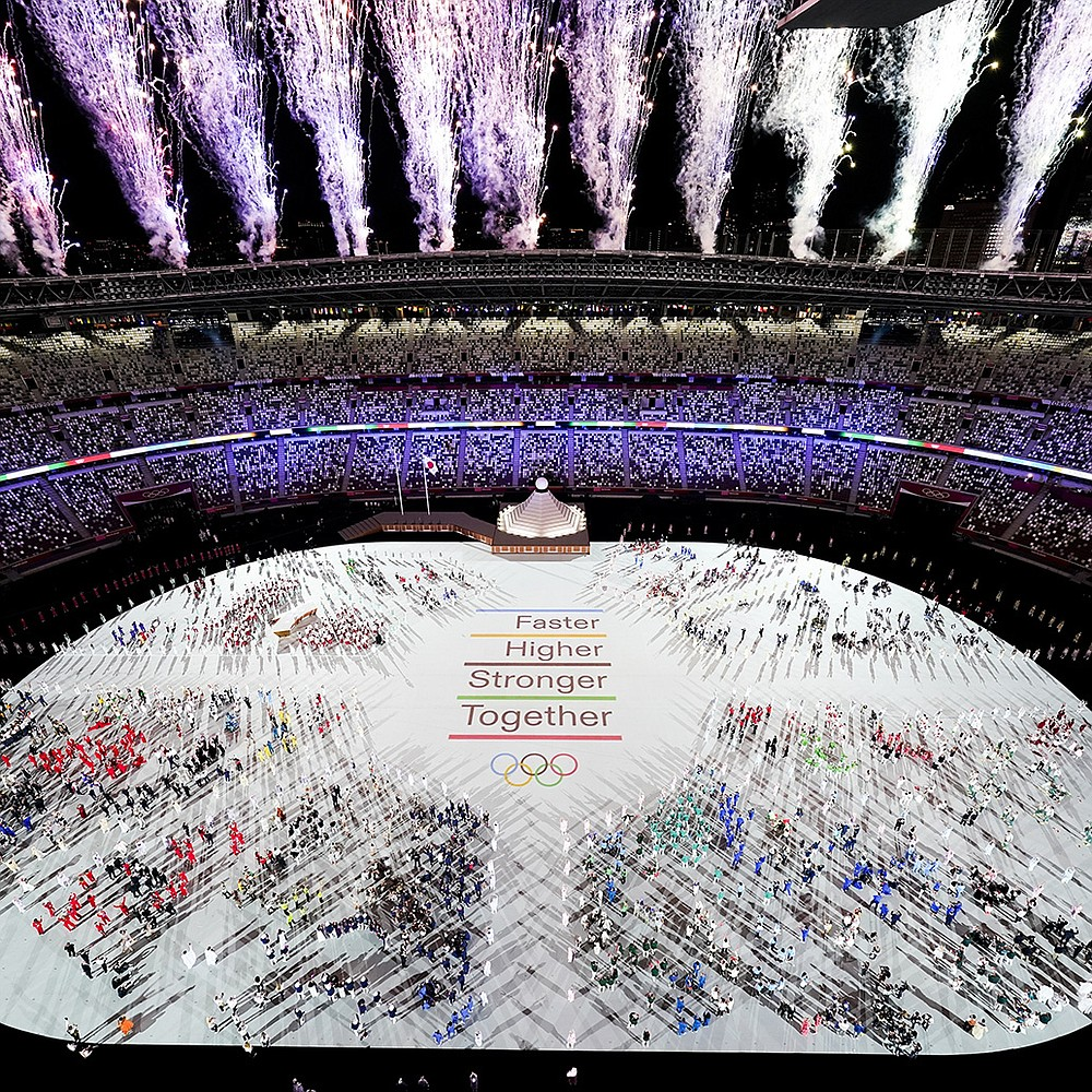 Fireworks herald the start of the Tokyo Olympics on Friday in an occasionally somber and sparsely attended opening ceremony for the games that were postponed for a year and begin under the threat of a covid-19 outbreak. For the next 16 days, with fans barred from attendance, Japanese officials and the International Olympic Committee will conduct what amounts to a carefully monitored, made-for-television event. (AP/Morry Gash)