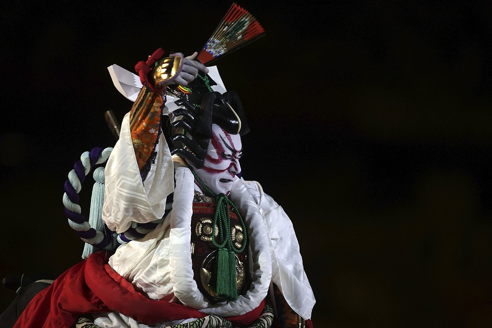 A performer participates in a traditional Japanese kabuki costume during the Olympic opening ceremony Friday in Tokyo. (AP/Hannah McKay)