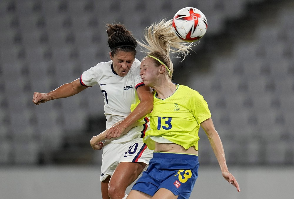 Carli Lloyd (left) and the United States women's soccer team try to even their record in Olympic play today when they take on New Zealand. Coverage begins at 6:30 a.m. Central on NBCSN. (AP/Ricardo Mazalan)
