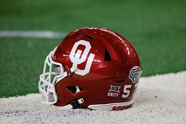 An Oklahoma helmet is shown on the field before their NCAA Cotton Bowl college football game against Florida in Arlington, Texas, Wednesday, Dec. 30, 2020. (AP Photo/Michael Ainsworth)