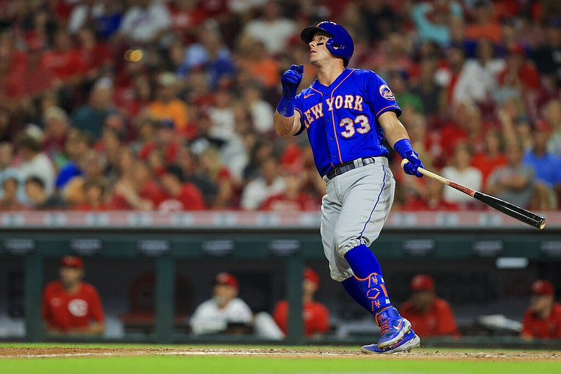 New York Mets' James McCann watches his two-run home run during the eighth inning of a baseball game against the Cincinnati Reds in Cincinnati, Monday, July 19, 2021. (AP Photo/Aaron Doster)