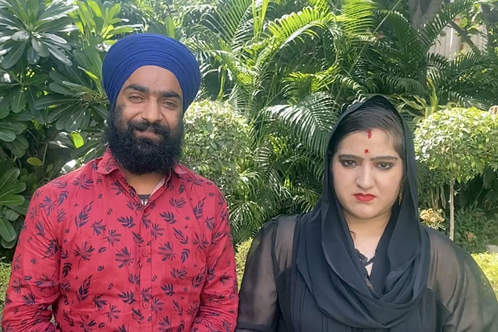 A photo provided by Manjinder Singh Sirsa, the head of the largest Sikh temple, in New Delhi, shows Manmeet Kour Bali (right), with her second husband. Days after appearing in court to defend her conversion to Islam to marry a Muslim man, Bali was married to a Sikh man. (Manjinder Singh Sirsa via The New York Times)