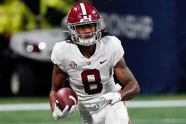 Alabama's John Metchie lll during the first half of the Southeastern Conference championship NCAA college football game, Saturday, Dec. 19, 2020, in Atlanta. (AP Photo/John Bazemore)