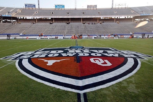 In this Oct. 10, 2020, photo, The Red River Showdown logo is displayed on the field of the Cotton Bowl, prior to an NCAA college football game between the University of Texas and Oklahoma, in Dallas. (AP Photo/Michael Ainsworth, File)