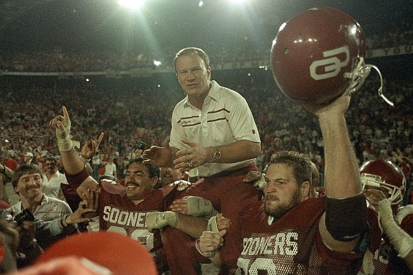 Oklahoma Sooners coach Barry Switzer gets a ride from jubilant players Tony Casillas, left, and an unidentified player, right, following their win over Penn State in the Orange Bowl in Miami, Jan. 2, 1986. (AP Photo/Mark Foley)