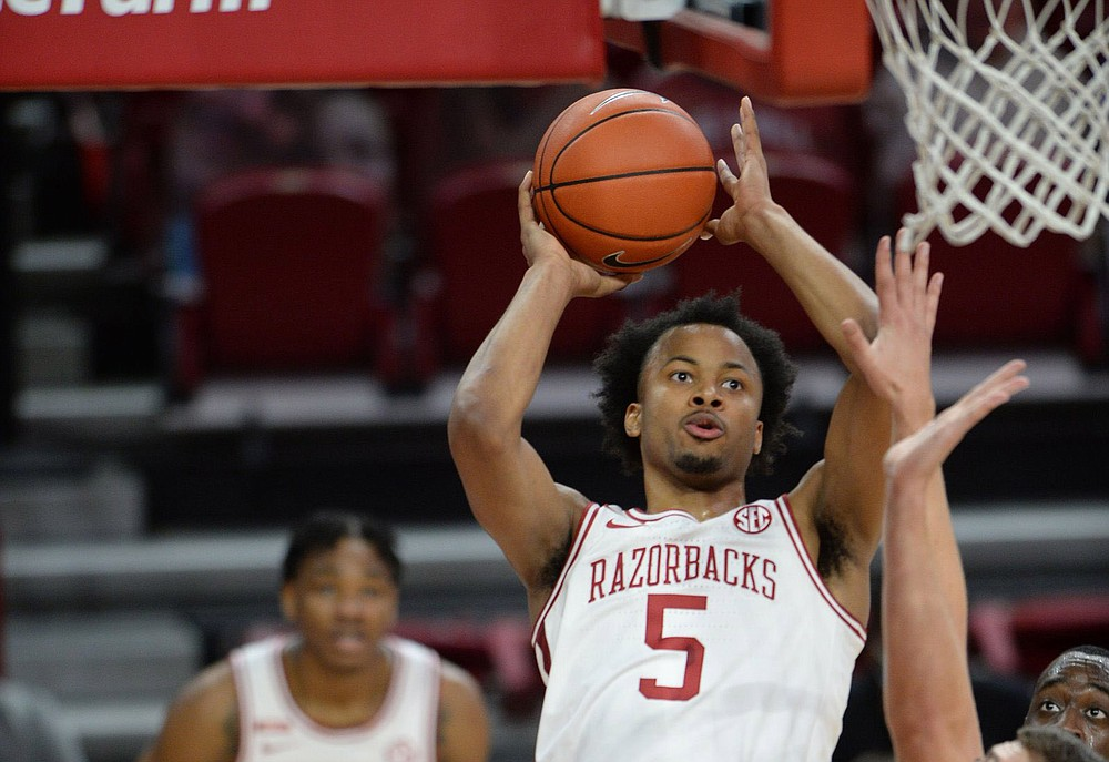 University of Arkansas guard Moses Moody is projected to be taken as high as seventh by the Golden State Warriors in tonight's NBA Draft and as low as 17th by the New Orleans Pelicans. (NWA Democrat-Gazette/Andy Shupe)