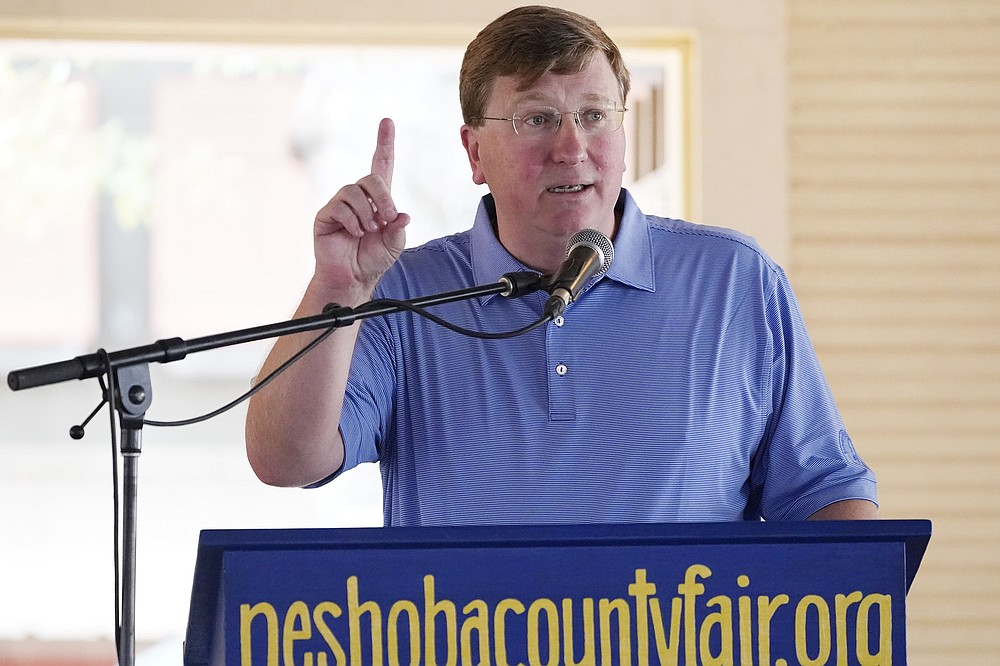 """Mississippi Gov. Tate Reeves, speaking Thursday at the Neshoba County Fair near Philadelphia, Miss., called a federal recommendation to wear masks indoors is """"foolish"""" and """"harmful,"""" saying it """"reeks of political panic so as to appear they are in control."""" (AP/Rogelio V. Solis)"""