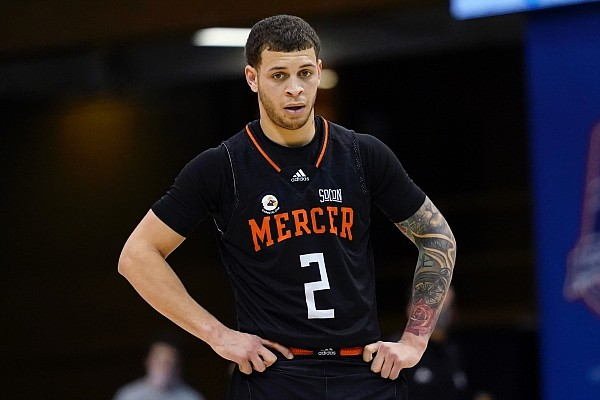 Mercer guard Neftali Alvarez (2) on the court against UNC-Greensboro in the first half of an NCAA men's college basketball championship game for the Southern Conference tournament, Monday, March 8, 2021, in Asheville, N.C. (AP Photo/Kathy Kmonicek)