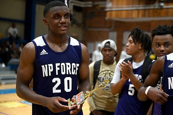 Derrian Ford accepts a trophy for MVP after his team, Next Page Force, won the Real Deal in the Rock 17U Championship game on Sunday, June 27, 2021.