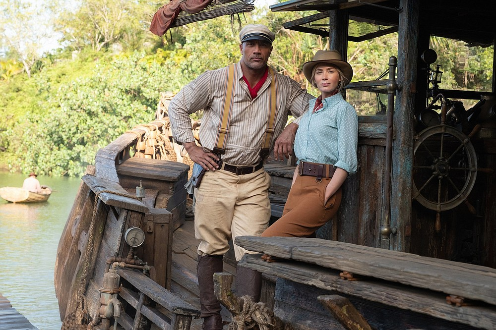 """Frank (Dwayne Johnson) and Lily (Emily Blunt) are a 21st-century analogue to Humphrey Bogart and Katharine Hepburn in """"The African Queen"""" in Disney's """"Jungle Cruise,"""" which also incorporates elements of '80s action adventure movies."""